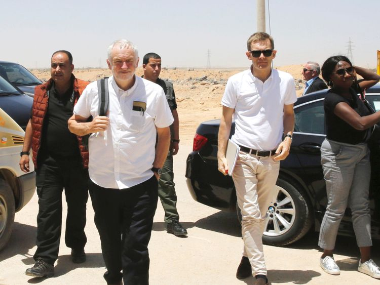 Britain's opposition leader Jeremy Corbyn walks during his visit to Al Zaatari refugee camp, in the Jordanian city of Mafraq, near the border with Syria, June 22, 2018. REUTERS/Muhammad Hamed