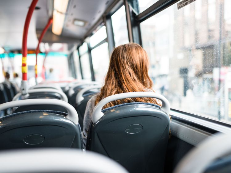 A woman on a bus