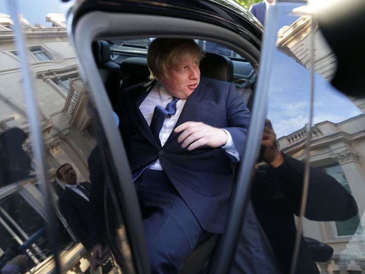 British Foreign Secretary Boris Johnson (C) gets into a car as he leaves after attending an event at the French Ambassador's residence in west London on July 14, 2016. Britain's new Prime Minister Theresa May showed several of her former cabinet colleagues the door Thursday, including top Brexit campaigner Michael Gove, while fellow 'Leave' supporter Boris Johnson was crowned top diplomat. / AFP / DANIEL LEAL-OLIVAS (Photo credit should read DANIEL LEAL-OLIVAS/AFP/Getty Images)