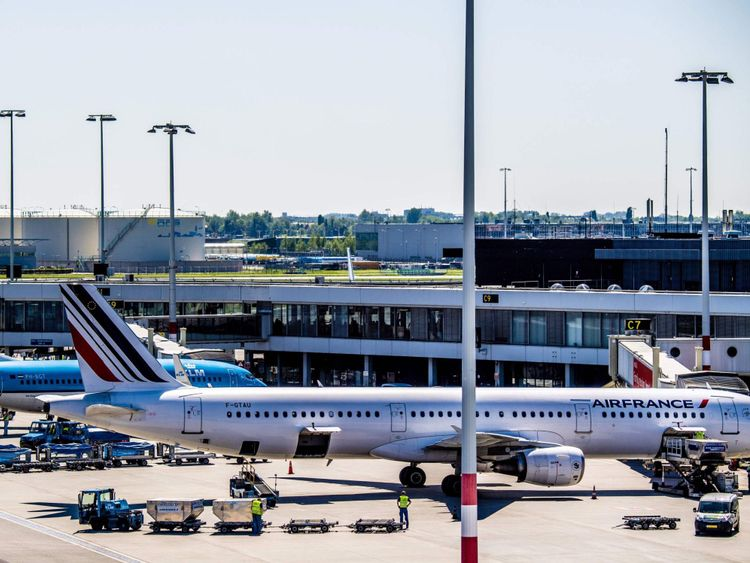 Air France and KLM aircrafts stand parked at Schiphol Airport, Netherlands, on May 7, 2018. - Air France shares went into a tailspin on the Paris stock exchange on May 7 after the strike-hit company's CEO resigned and the government seemed to worry about the carrier's very chances of survival. (Photo by Robin Utrecht / ANP / AFP) / Netherlands OUT (Photo credit should read ROBIN UTRECHT/AFP/Getty Images)