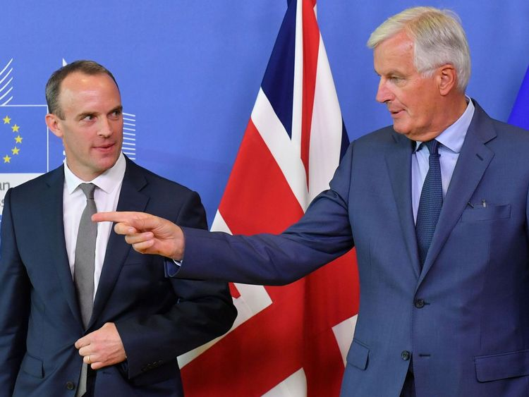 EU Chief Brexit Negotiator Michel Barnier (R) and Britain's Brexit Secretary Dominic Raab pose during their meeting at the European Commission in Brussels on August 31, 2018. (Photo by Emmanuel DUNAND / AFP) (Photo credit should read EMMANUEL DUNAND/AFP/Getty Images)