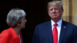 Theresa May poses for a photograph with U.S. President Donald Trump at Chequers
