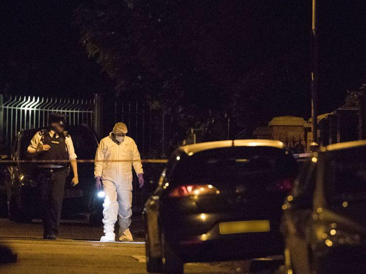 Police and forensic investigators at the scene of Gerry Adams house