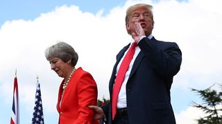 Theresa May and Donald Trump walk away after holding a joint news conference at Chequers