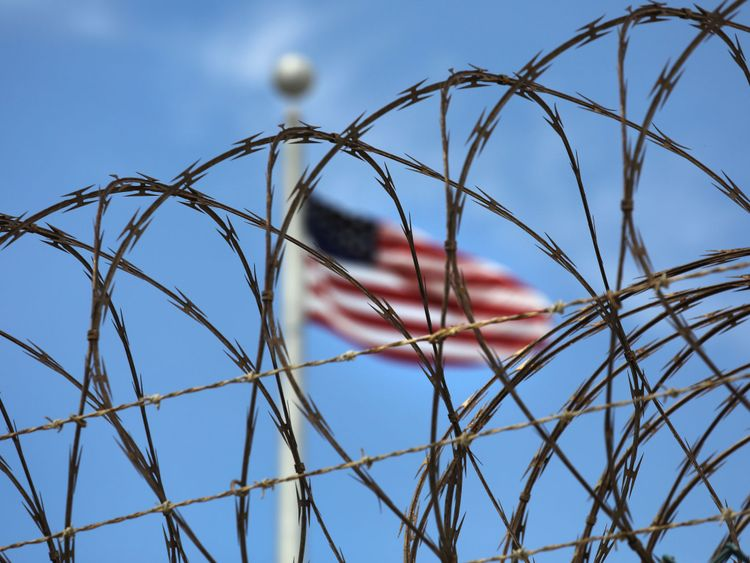 Razor wire tops the fence of the US prison at Guantanamo Bay, also known as 'Gitmo'
