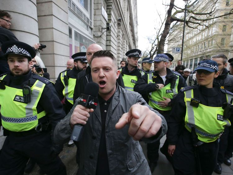 Stephen Christopher Yaxley-Lennon, AKA Tommy Robinson, former leader of the right-wing EDL (English Defence League) is escorted away by police from a Britain First march and an English Defence League march in central London on April 4, 2017
