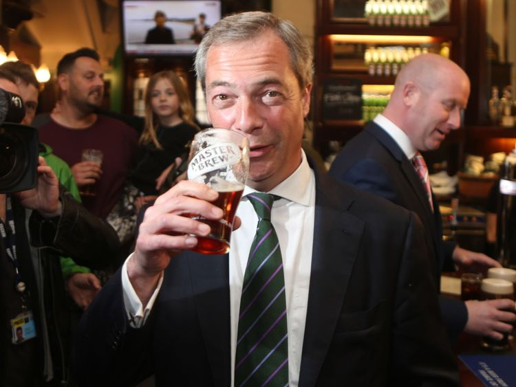 Ukip leader Nigel Farage has a pint in the Westminster Arms, London, as he celebrates his party's results in the polls for the European Parliament.