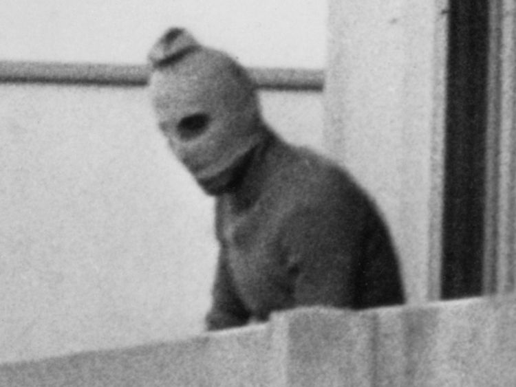 MUNICH, GERMANY - SEPTEMBER 5, 1972: (FILE PHOTO) One of the eight Palestinian terrorists comprising the Black September group stands on a balcony of the Olympic village during a standoff after they kidnapped nine members of the Israeli Olympic team and killed two others September 5, 1972 in Munich, Germany.