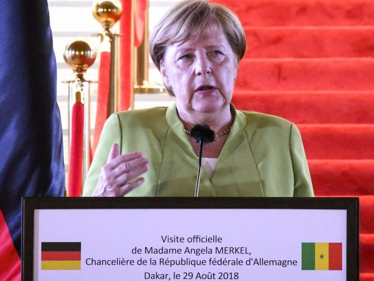 Germany's Chancellor Angela Merkel speaks during a joint press conference with Senegal's President after their meeting, on August 29, 2018 in Dakar, the first stop on a three country tour of Africa which also includes Ghana and Nigeria. (Photo by SEYLLOU / AFP) (Photo credit should read SEYLLOU/AFP/Getty Images)