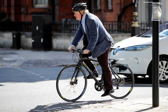 Boris Johnson riding a bike