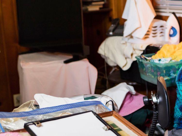 Senior woman at home, messy room