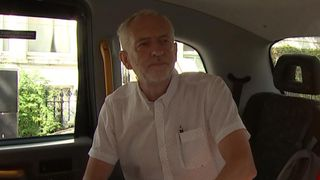 Jeremy Corbyn is brief with the press as he boards a taxi