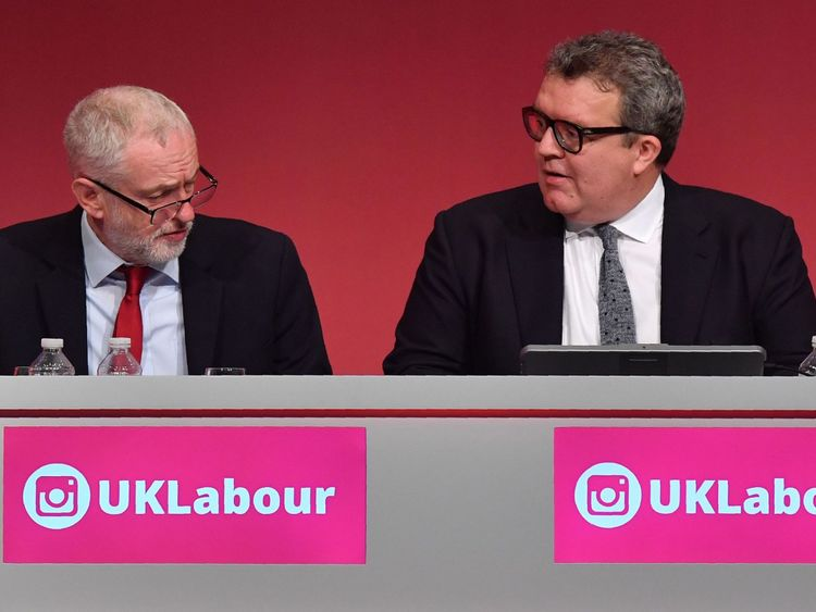 Labour Party leader Jeremy Corbyn (L) sits alongside deputy leader Tom Watson at the Labour Party conference in 2017