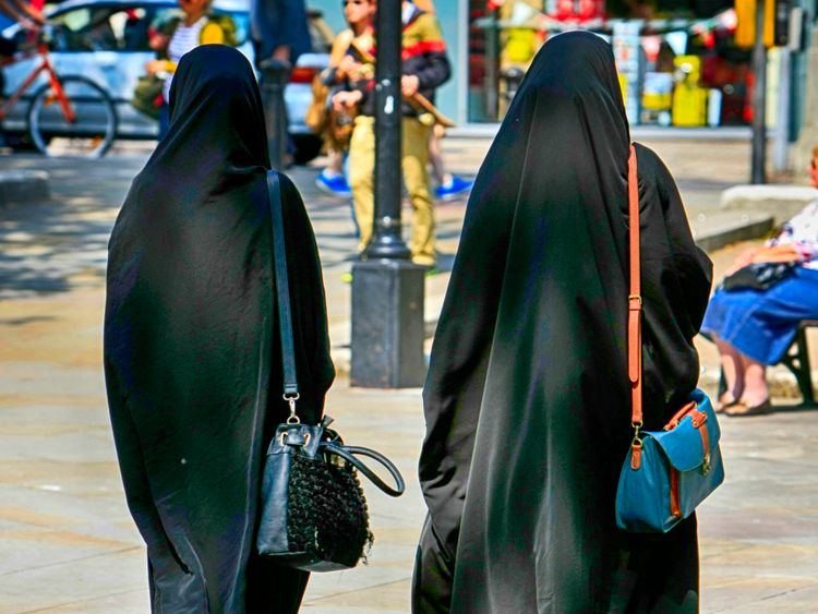 Two Muslim women in burkas walking in Bristol