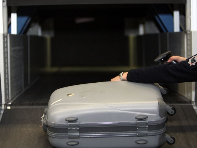 A UK Border Agency officer uses the new  xylon machine at Heathrow Airport. PRESS ASSOCIATION Photo. Picture date: Thursday January 6, 2011 See PA story . Photo credit should read: Steve Parsons/PA Wire