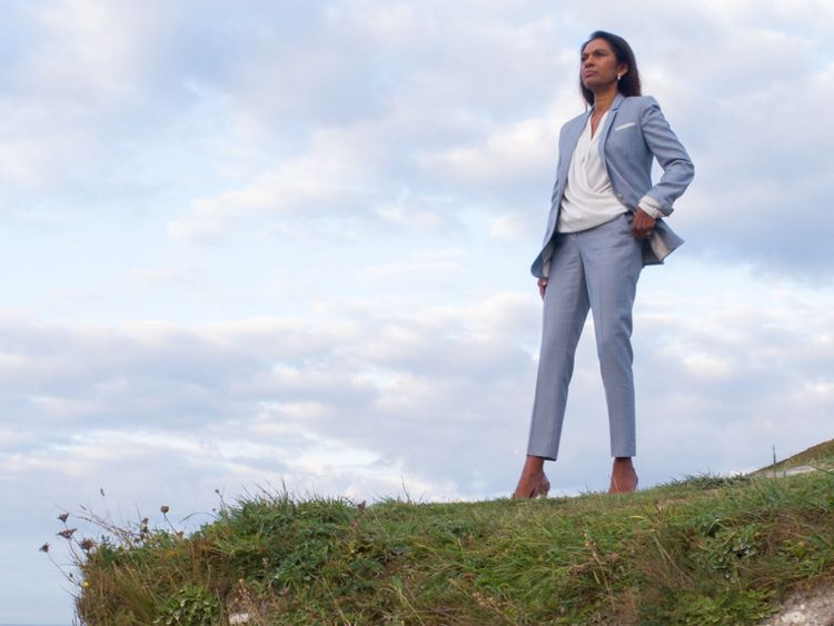 Gina Miller posing on the White Cliffs of Dover