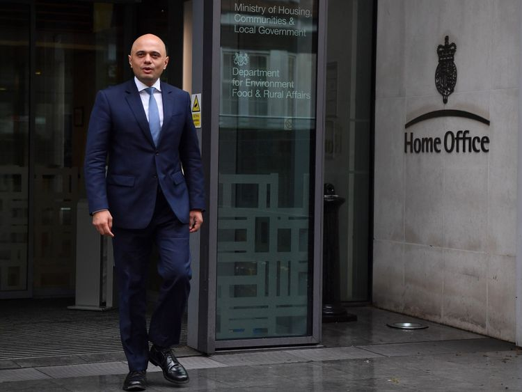 Britain's newly appointed Home Secretary Sajid Javid exits the Home Office to pose for a photograph in central London on April 30, 2018. - Sajid Javid was named Monday as Britain's new interior minister after Amber Rudd resigned as home secretary, having 'inadvertently misled' lawmakers about deportation targets for illegal immigrants. Prime Minister Theresa May's Downing Street office announced the appointment in a statement. Javid was previously Britain's communities minister. (Photo by Ben ST