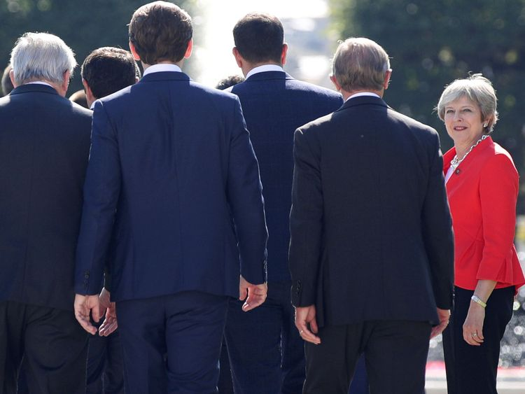 Theresa May arrives for a family photo during the European Union leaders informal summit in Salzburg, Austria
